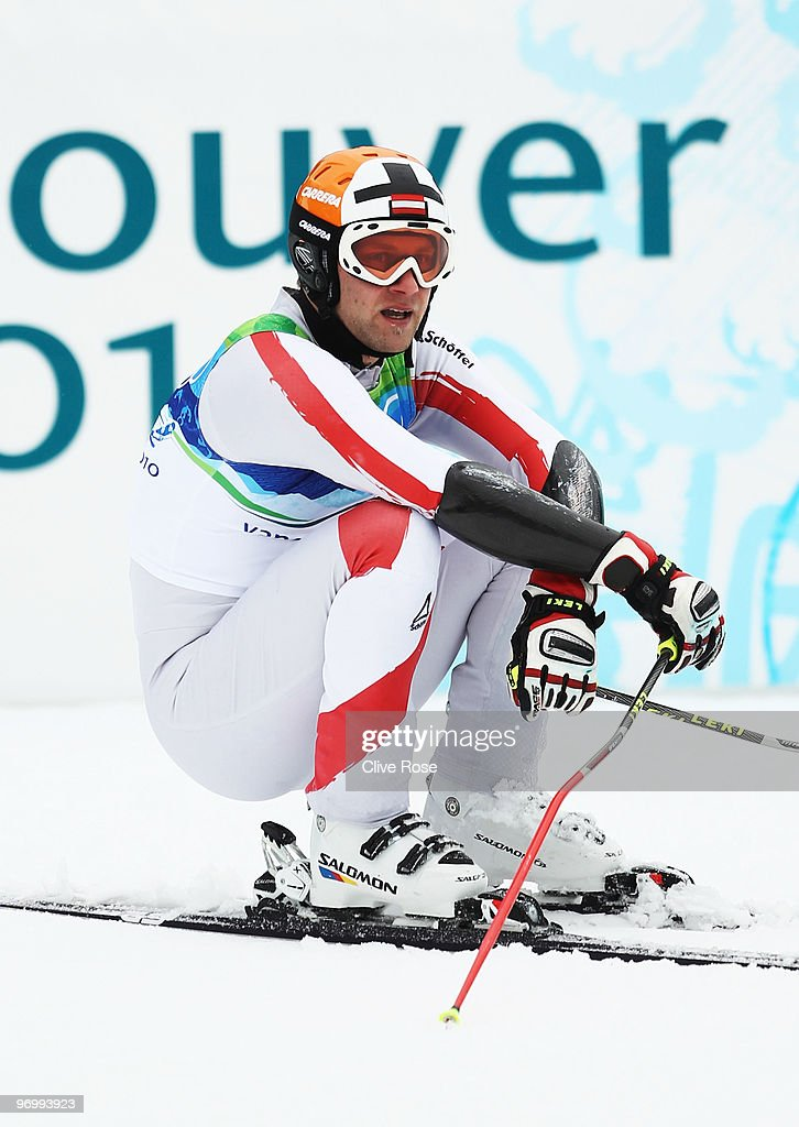 Romed Baumann of Austria reacts after his second run during the Alpine Skiing Men's Giant Slalom on day 12 of the Vancouver 2010 Winter Olympics at...