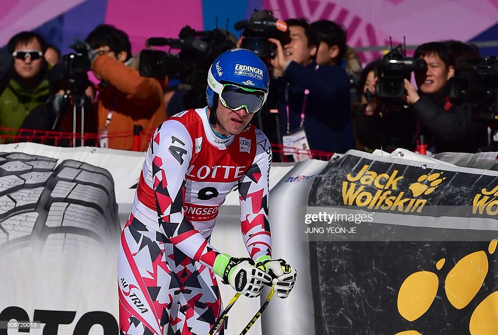 Romed Baumann of Austria reacts at the finish during the 8th men's downhill event of the FIS Alpine Ski World Cup at Jeongseon Alpine Centre in Jeongseon county, some 150km east of Seoul, on February 6, 2016. The FIS Ski Men's World Cup runs from February 6-7 and is the first official test event for the Pyeongchang 2018 Winter Olympics. AFP PHOTO / JUNG YEON-JE / AFP / JUNG YEON-JE