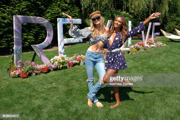 Romee Strijd and Jasmine Tookes toast to #REVOLVEintheHamptons with Moet Chandon on July 4 2017 in Bridgehampton New York