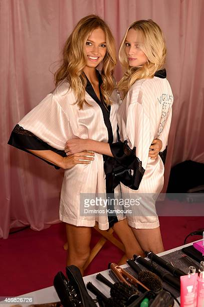 Romee Strijd and Maud Welzen are seen backstage prior the 2014 Victoria's Secret Fashion Show on December 2 2014 in London England