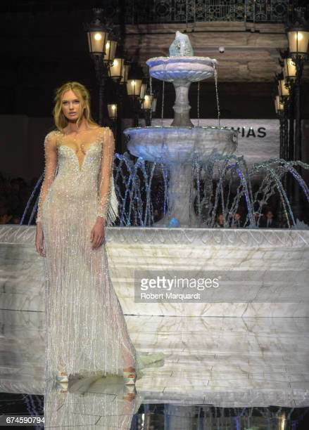 Romee Strijd walks the runway for the Pronovias Show during Barcelona Bridal Fashion Week 2017 held at the Museu Nacional d'Art de Catalunya on April...