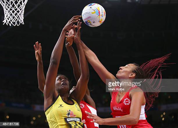 Romelda Aiken of Jamaica and Geva Mentor of England compete for the ball during the 2015 Netball World Cup Bronze Medal match between England and...