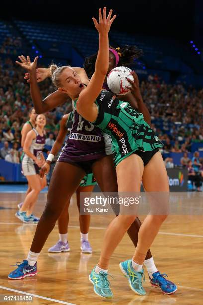 Romelda Aiken of the Firebirds and Courtney Bruce of the Fever contest for the ball during the round three Super Netball match between the Fever and...