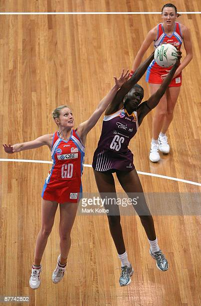 Romelda Aiken of the Firebirds secures the ball under pressure from Kimberley Smith of the Swifts during the round seven ANZ Championships match...