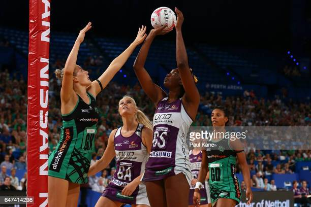 Romelda Aiken of the Firebirds shoots the ball during the round three Super Netball match between the Fever and the Firebirds at Perth Arena on March...