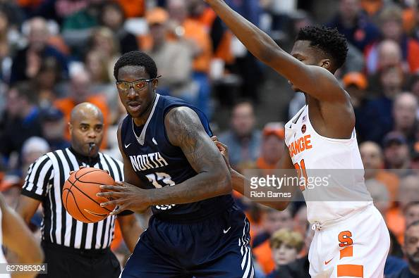Romelo Banks of the North Florida Ospreys controls the ball as Tyler Roberson of the Syracuse Orange defends during the second half at the Carrier...