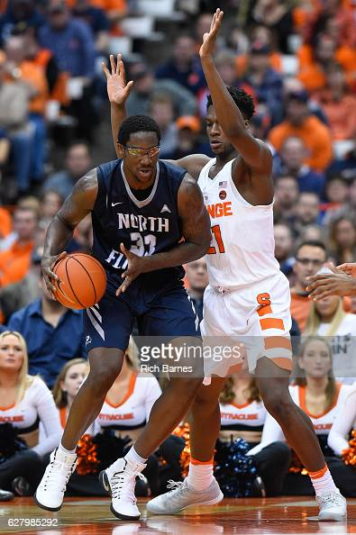Romelo Banks of the North Florida Ospreys drives to the basket as Tyler Roberson of the Syracuse Orange defends during the second half at the Carrier...