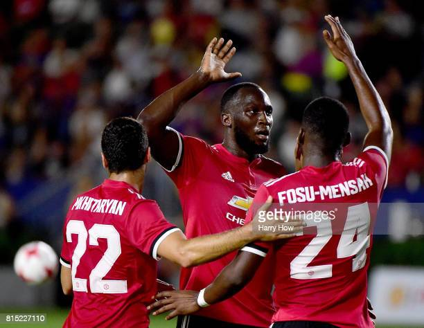 Romelo Lukaku of Manchester United celebrates a goal from Anthony Martial with Timothy FosuMensah and Henrikh Mkhitaryan to take a 50 lead during the...