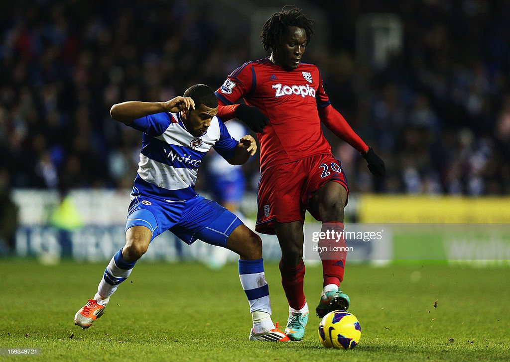 Romelu Lukaka of West Bromwich Albion battles with <a gi-track='captionPersonalityLinkClicked' href=/galleries/search?phrase=Adrian+Mariappa&family=editorial&specificpeople=661604 ng-click='$event.stopPropagation()'>Adrian Mariappa</a> of Reading during the Barclays Premier League match between Reading and West Bromwich Albion at the Madejski Stadium on January 12, 2013 in Reading, England.