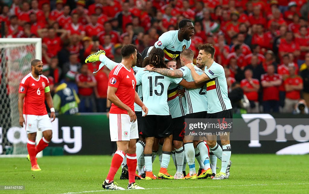 Romelu Lukaku (top) and Belgium players celebrate their team's first goal by Radja Nainggolan (obscured) during the UEFA EURO 2016 quarter final match between Wales and Belgium at Stade Pierre-Mauroy on July 1, 2016 in Lille, France.