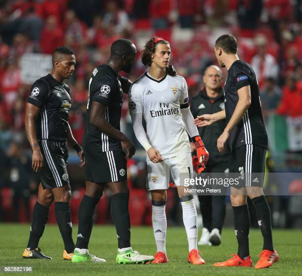 Romelu Lukaku and Nemanja Matic of Manchester United console Mile Svilar of Benfica after the UEFA Champions League group A match between SL Benfica...