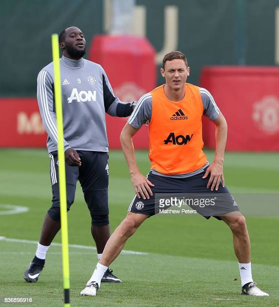 Romelu Lukaku and Nemanja Matic of Manchester United in action during a first team training session at Aon Training Complex on August 22 2017 in...