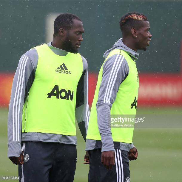 Romelu Lukaku and Paul Pogba of Manchester United in action during a first team training session at Aon Training Complex on August 1 2017 in...