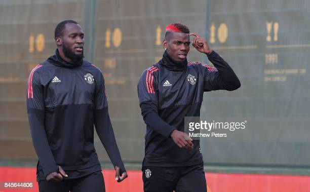 Romelu Lukaku and Paul Pogba of Manchester United in action during a first team training session at Aon Training Complex on September 11 2017 in...