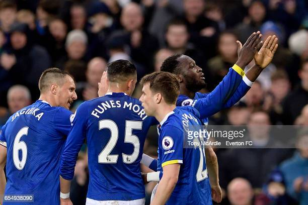 Romelu Lukaku celebrates his first goal with Phil Jagielka Seamus Coleman and Ramiro Funes Mori during the Premier League match between Everton and...
