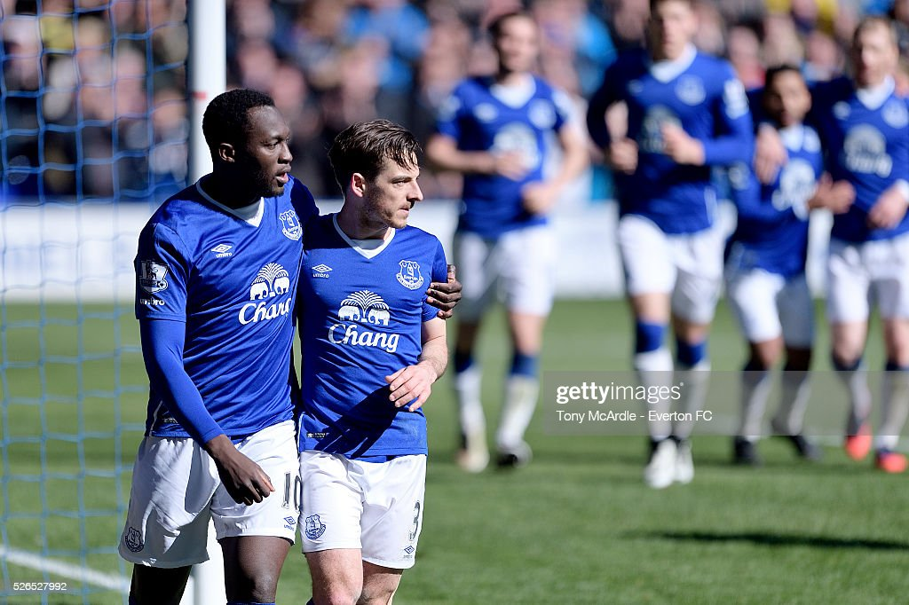 Romelu Lukaku (L) celebrates the goal scored by Leighton Baines during the Barclays Premier League match between Everton and A.F.C. Bournemouth at Goodison Park on April 30, 2016 in Liverpool, England.
