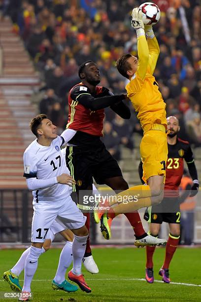 Romelu Lukaku forward of Belgium battles for the ball with Mihkel Aksalu goalkeeper of Estonia during the World Cup Qualifier Group H match between...