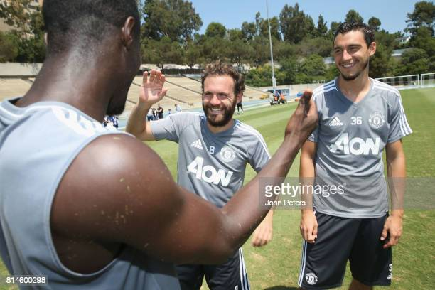 Romelu Lukaku Juan Mata and Matteo Darmian of Manchester United in action during a first team training session as part of their preseason tour of the...