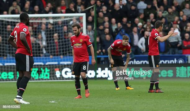 Romelu Lukaku Juan Mata Victor Lindelof and Ander Herrera of Manchester United react to conceding a goal to Laurent Depoitre of Huddersfield Town...