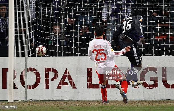Romelu Lukaku of Anderlecht scores his team's first goal as Tomas Rincon of Hamburg looks on during the UEFA Europa League round of 16 second leg...