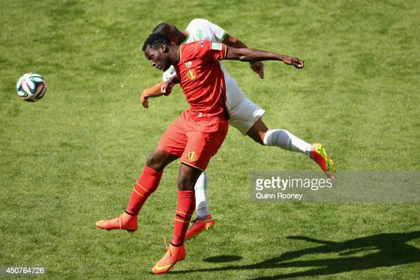 Romelu Lukaku of Belgium and Faouzi Ghoulam of Algeria go up for a header during the 2014 FIFA World Cup Brazil Group H match between Belgium and...