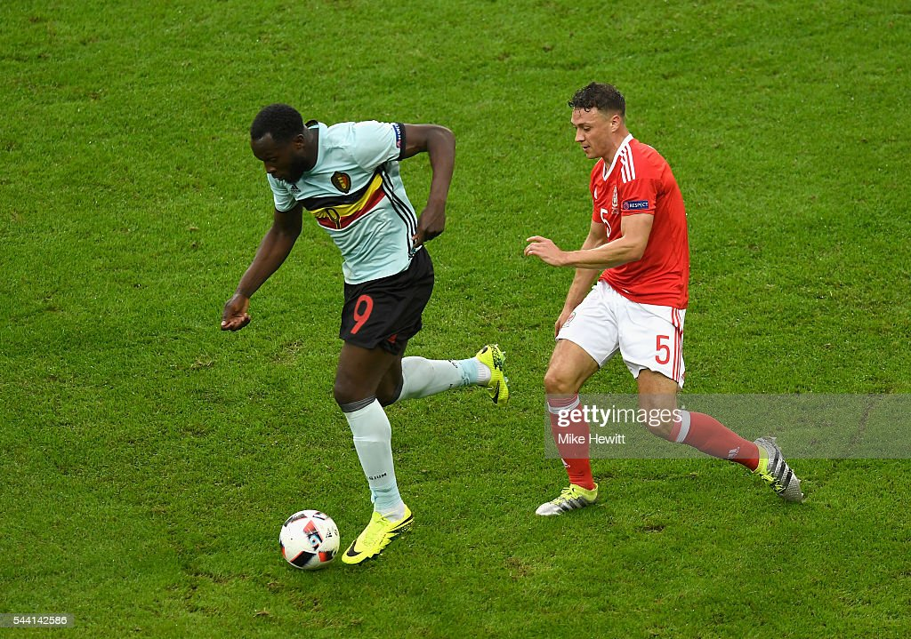 <a gi-track='captionPersonalityLinkClicked' href=/galleries/search?phrase=Romelu+Lukaku&family=editorial&specificpeople=6342802 ng-click='$event.stopPropagation()'>Romelu Lukaku</a> of Belgium and <a gi-track='captionPersonalityLinkClicked' href=/galleries/search?phrase=James+Chester&family=editorial&specificpeople=4192570 ng-click='$event.stopPropagation()'>James Chester</a> of Wales compete for the ball during the UEFA EURO 2016 quarter final match between Wales and Belgium at Stade Pierre-Mauroy on July 1, 2016 in Lille, France.