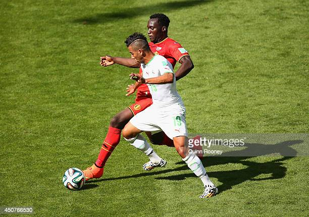 Romelu Lukaku of Belgium and Saphir Taider of Algeria battle for the ball during the 2014 FIFA World Cup Brazil Group H match between Belgium and...