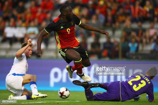 Romelu Lukaku of Belgium battles for the ball with Tomas Kalas of the Czech Republic they has his shot stopped by Goalkeeper Jiri Pavlenka during the...