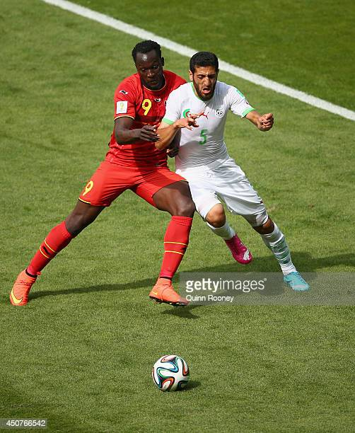 Romelu Lukaku of Belgium challenges Rafik Halliche of Algeria during the 2014 FIFA World Cup Brazil Group H match between Belgium and Algeria at...