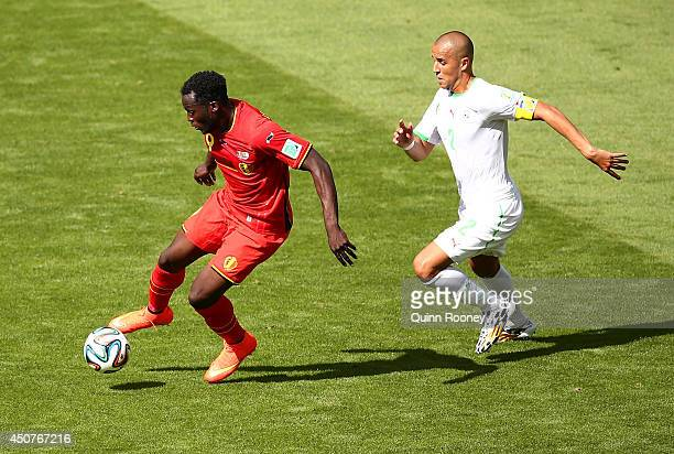 Romelu Lukaku of Belgium controls the ball as Madjid Bougherra of Algeria gives chase during the 2014 FIFA World Cup Brazil Group H match between...