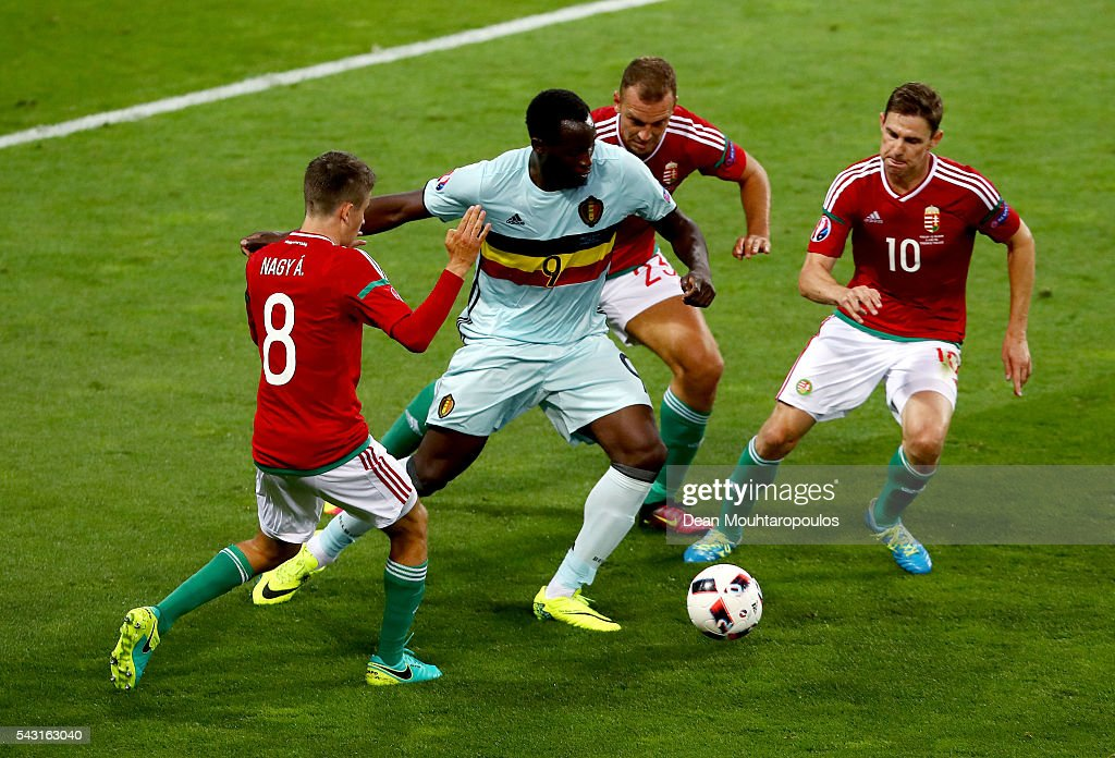 <a gi-track='captionPersonalityLinkClicked' href=/galleries/search?phrase=Romelu+Lukaku&family=editorial&specificpeople=6342802 ng-click='$event.stopPropagation()'>Romelu Lukaku</a> (2nd L) of Belgium controls the ball under pressure of Adam Nagy (1st L), Roland Juhasz (2nd R) and <a gi-track='captionPersonalityLinkClicked' href=/galleries/search?phrase=Zoltan+Gera&family=editorial&specificpeople=216370 ng-click='$event.stopPropagation()'>Zoltan Gera</a> (1st R) of Hungary during the UEFA EURO 2016 round of 16 match between Hungary and Belgium at Stadium Municipal on June 26, 2016 in Toulouse, France.
