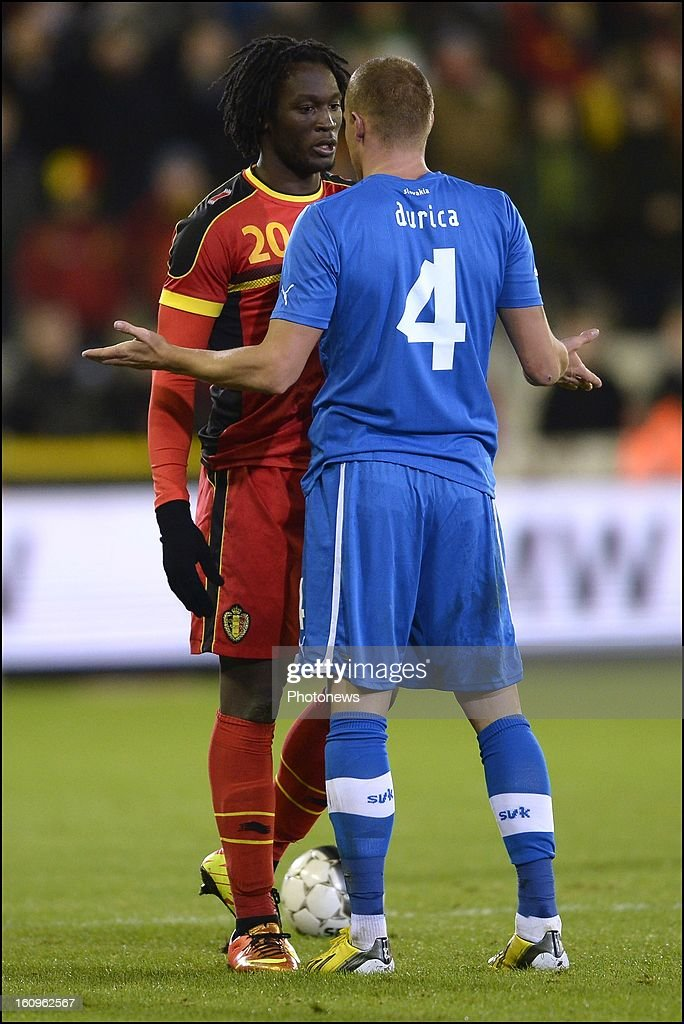 <a gi-track='captionPersonalityLinkClicked' href=/galleries/search?phrase=Romelu+Lukaku&family=editorial&specificpeople=6342802 ng-click='$event.stopPropagation()'>Romelu Lukaku</a> of Belgium (20) in discussion with <a gi-track='captionPersonalityLinkClicked' href=/galleries/search?phrase=Jan+Durica&family=editorial&specificpeople=765416 ng-click='$event.stopPropagation()'>Jan Durica</a> of Slovakia (4) during a FIFA international friendly match between Belgium and Slovakia at theJan Breydel stadium on February 06, 2013 in Brugge, Belgium