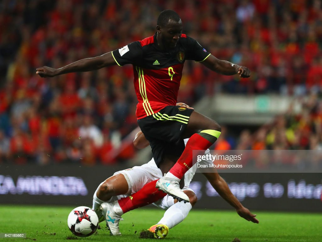Romelu Lukaku of Belgium is tackled by Jason Pusey of Gibraltar during the FIFA 2018 World Cup Qualifier between Belgium and Gibraltar at Stade Maurice Dufrasne on August 31, 2017 in Liege, Belgium.