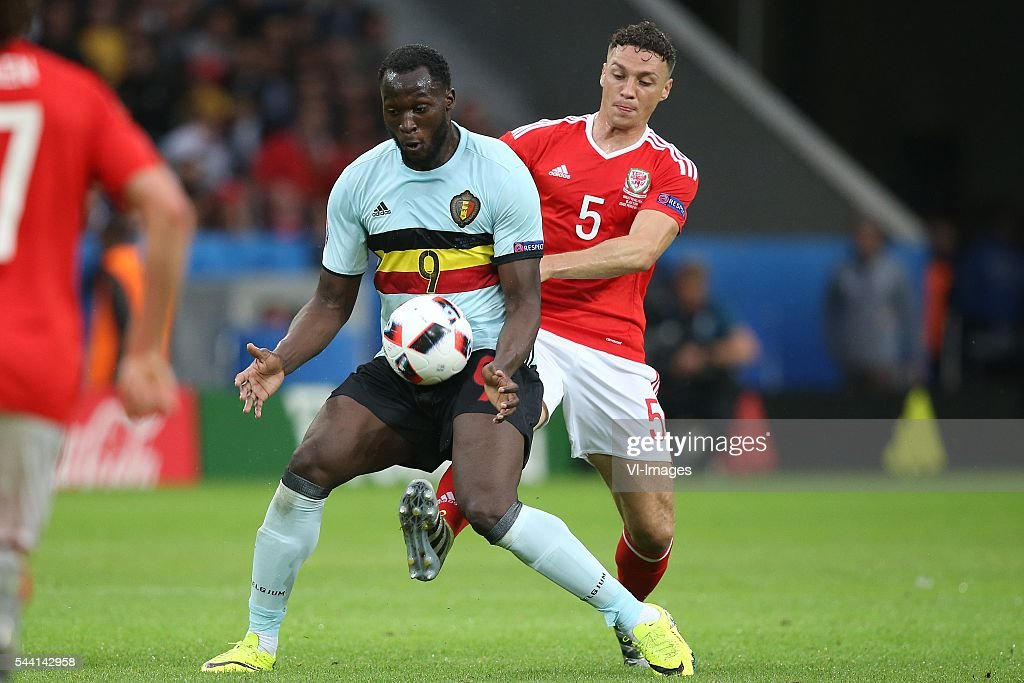 Romelu Lukaku of Belgium, James Chester of Wales during the UEFA EURO 2016 quarter final match between Wales and Belgium on July 2, 2016 at the Stade Pierre Mauroy in Lille, France.