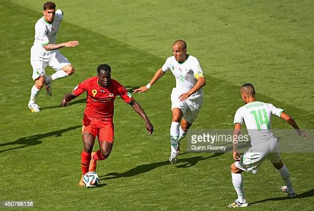 Romelu Lukaku of Belgium takes on Madjid Bougherra of Algeria during the 2014 FIFA World Cup Brazil Group H match between Belgium and Algeria at...