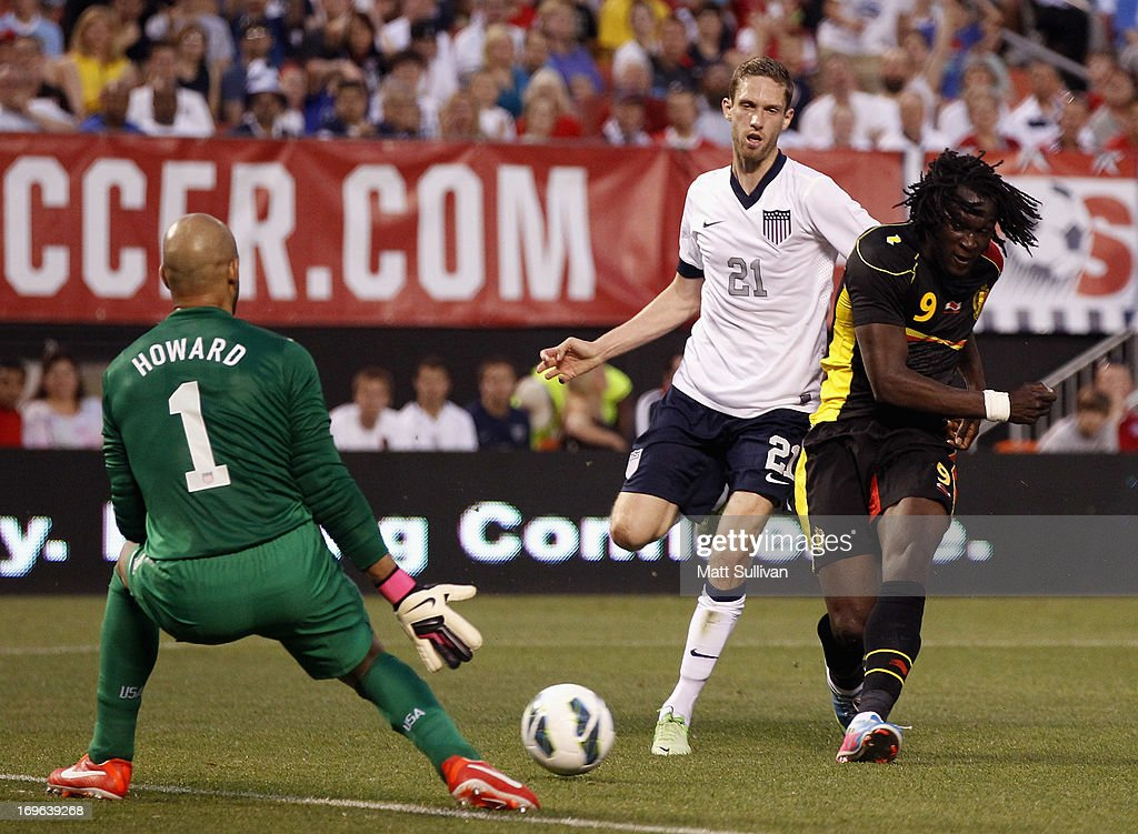Romelu Lukaku of Belguim shoots on Tim Howard of the US Mens National Team as Clarence Goodson looks on during their International Friendly match at...