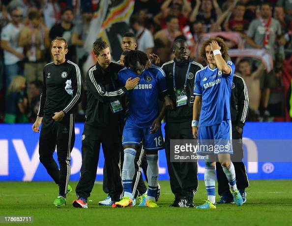 Romelu Lukaku of Chelsea is consoled by his team mates after missing his penalty in the penalty shoot out during the UEFA Super Cup between Bayern...