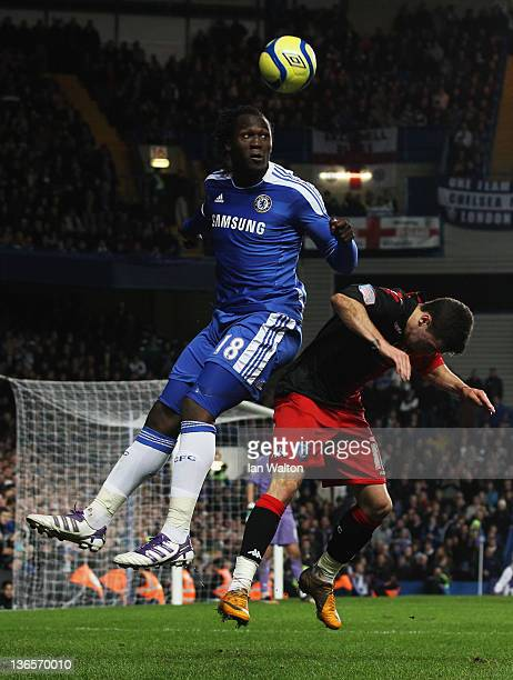 Romelu Lukaku of Chelsea outjumps Ryan Williams of Portsmouth during the FA Cup sponsored by Budweiser Third Round match between Chelsea and...