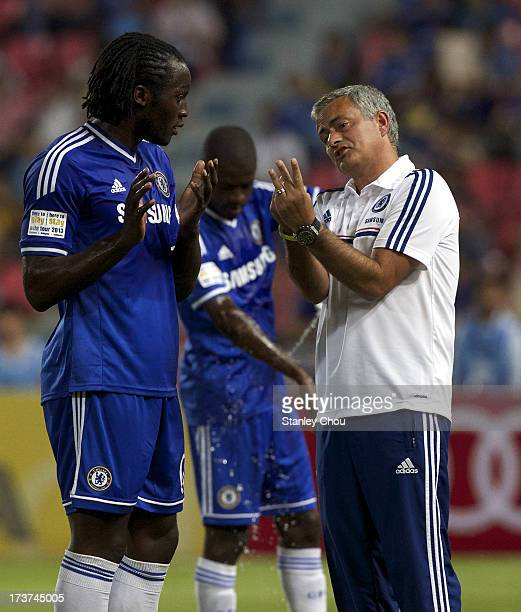 Romelu Lukaku of Chelsea speaks with Jose Mourinho coach of Chelsea during the international friendly match between Chelsea FC and the Singha...