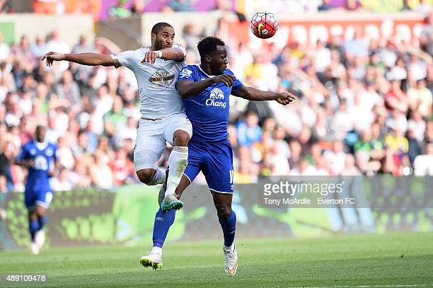 Romelu Lukaku of Everton and Ashley Williams challenge for a header during the Barclays Premier League match between Swansea City and Everton on...