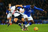 Romelu Lukaku of Everton battlea for the ball with Erik Lamela of Tottenham Hotspur during the Barclays Premier League match between Everton and...