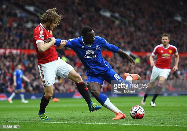 Romelu Lukaku of Everton battles with Daley Blind of Manchester United during the Barclays Premier League match between Manchester United and Everton...