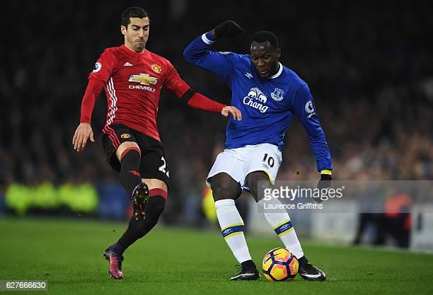 Romelu Lukaku of Everton beats Henrikh Mkhitaryan of Manchester United during the Premier League match between Everton and Manchester United at...