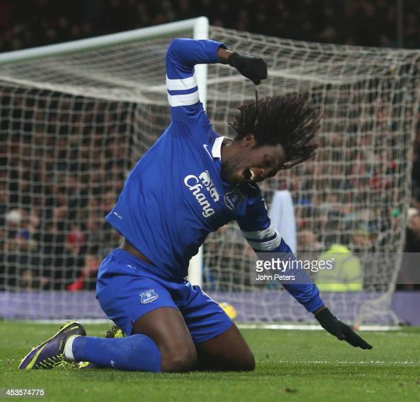 Romelu Lukaku of Everton celebrates Bryan Oviedo scoring their first goal during the Barclays Premier League match between Manchester United and...