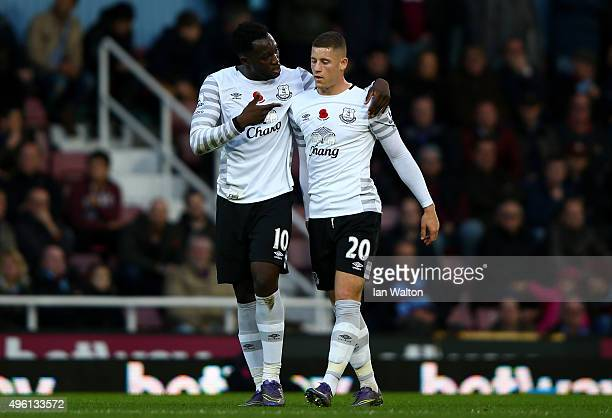 Romelu Lukaku of Everton celebrates scoring his team's first goal with his team mate Ross Barkley during the Barclays Premier League match between...