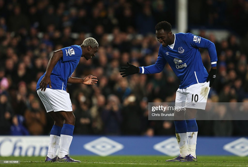 Romelu Lukaku of Everton celebrates scoring his team's fourth goal with his team mate Arouna Kone during the Barclays Premier League match between...