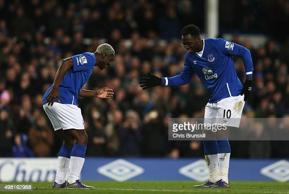 Romelu Lukaku of Everton celebrates scoring his team's fourth goal with his team mate Arouna Kone during the Barclays Premier League match between...