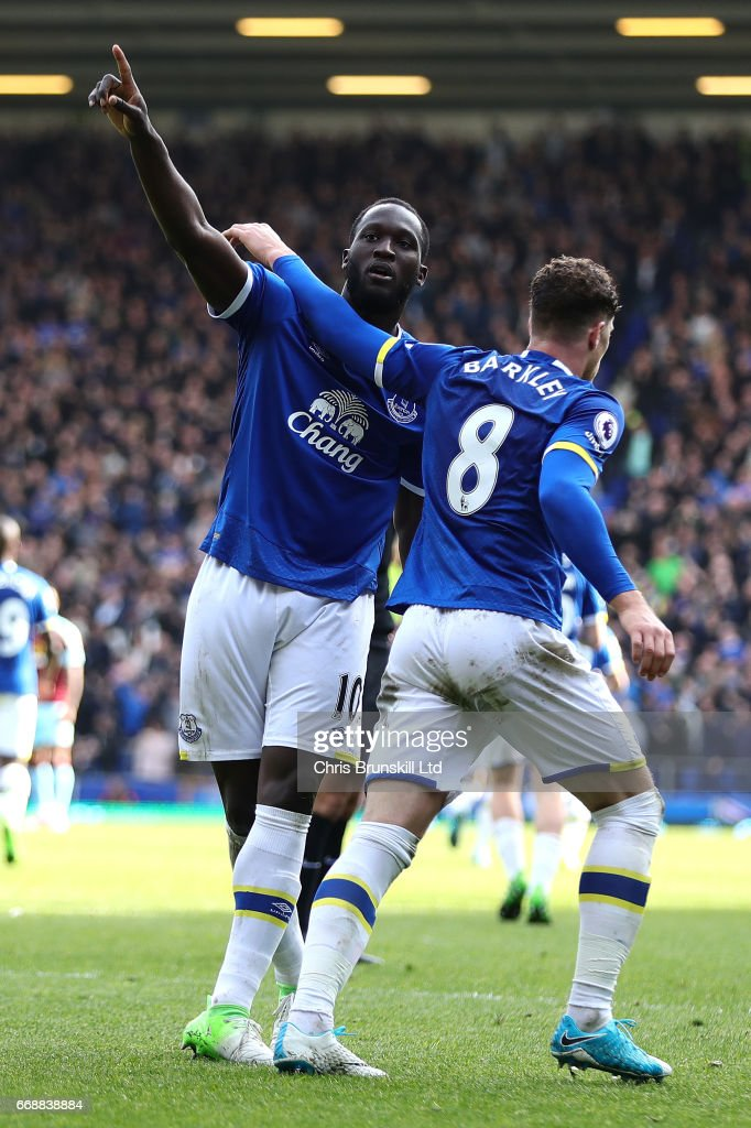 Romelu Lukaku of Everton celebrates scoring his team's third goal to make the score 3-1 with Ross Barkley during the Premier League match between Everton and Burnley at Goodison Park on April 15, 2017 in Liverpool, England.
