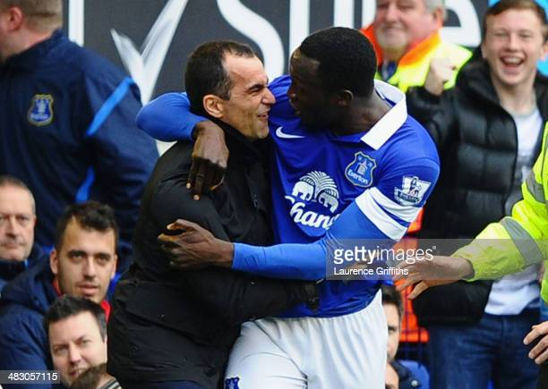 Romelu Lukaku of Everton celebrates scoring the second goal with Manager Roberto Martinez during the Barclays Premier League match between Everton...