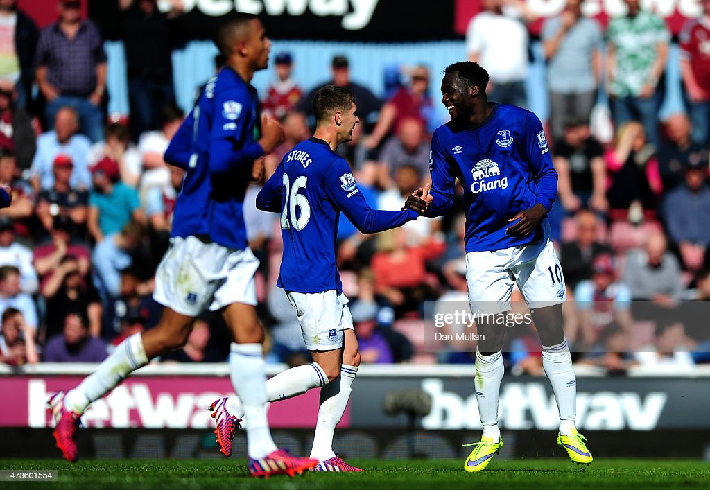 Romelu Lukaku of Everton (R) celebrates scoring their second goal pwith John Stones of Everton during the Barclays Premier League match between West Ham United and Everton at Boleyn Ground on May 16, 2015 in London, England.